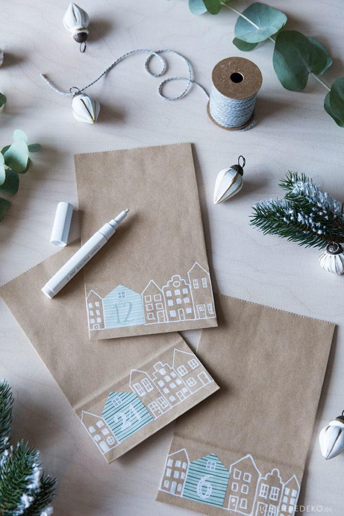 diy-adventskalender-aus-kraftpapiertueten-mit-gezeichneten-haeusern