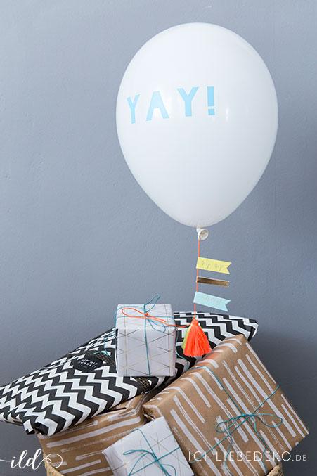 kreative-geschenkverpackung-fuer-babyparty-mit-luftballon-von-meri-meri