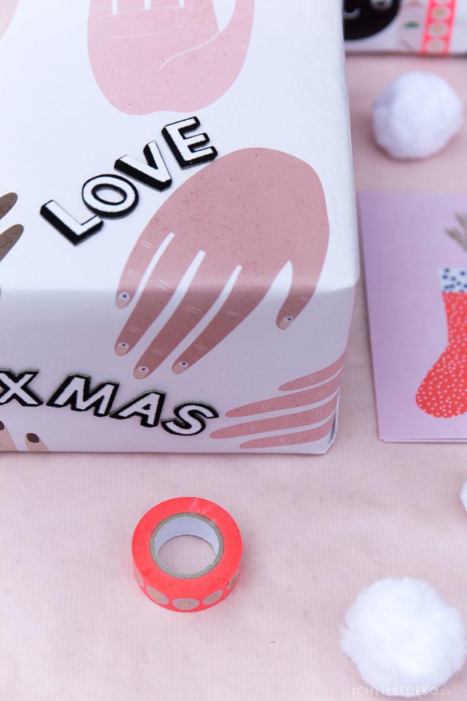 trendy Weihnachtspapier mit Händen